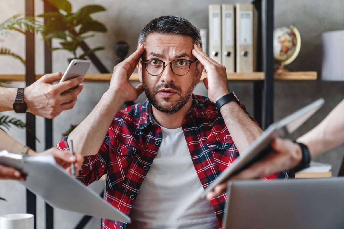 Man getting anxiety from hidden stressors in life.